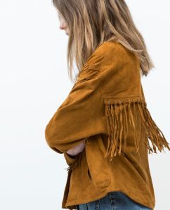 suede and fringe portada
