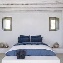 dormitorio principal en blanco y azul